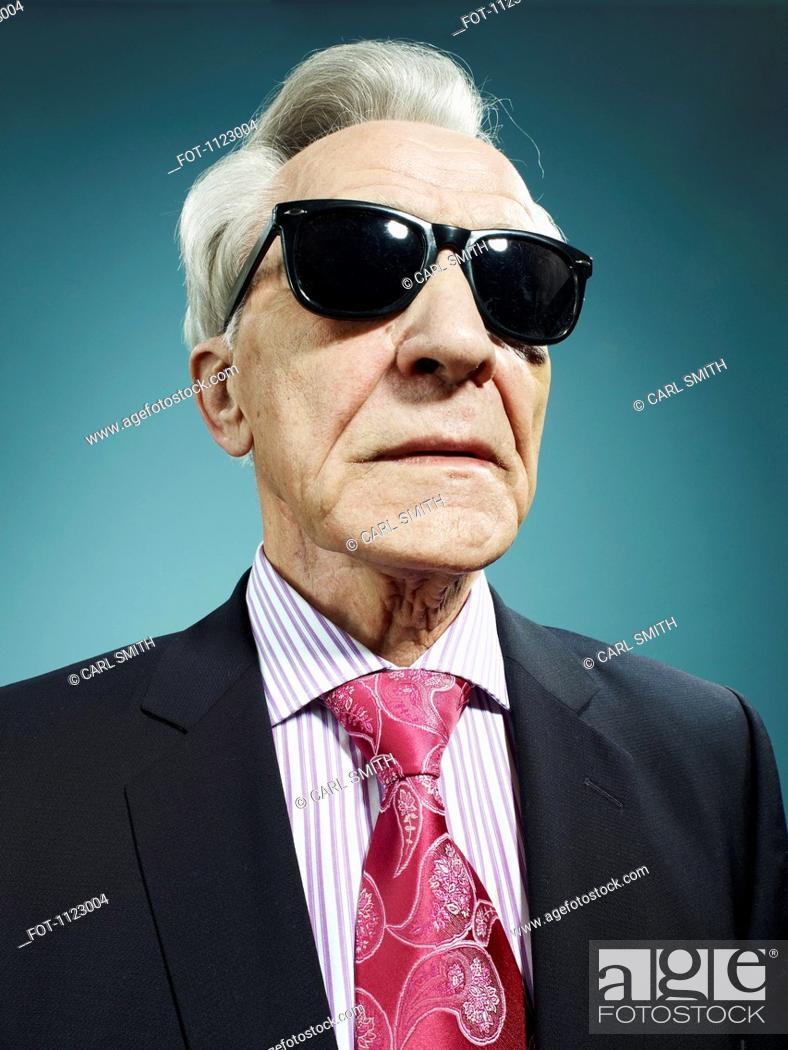 Stock Photo: An elegant senior man wearing sunglasses.