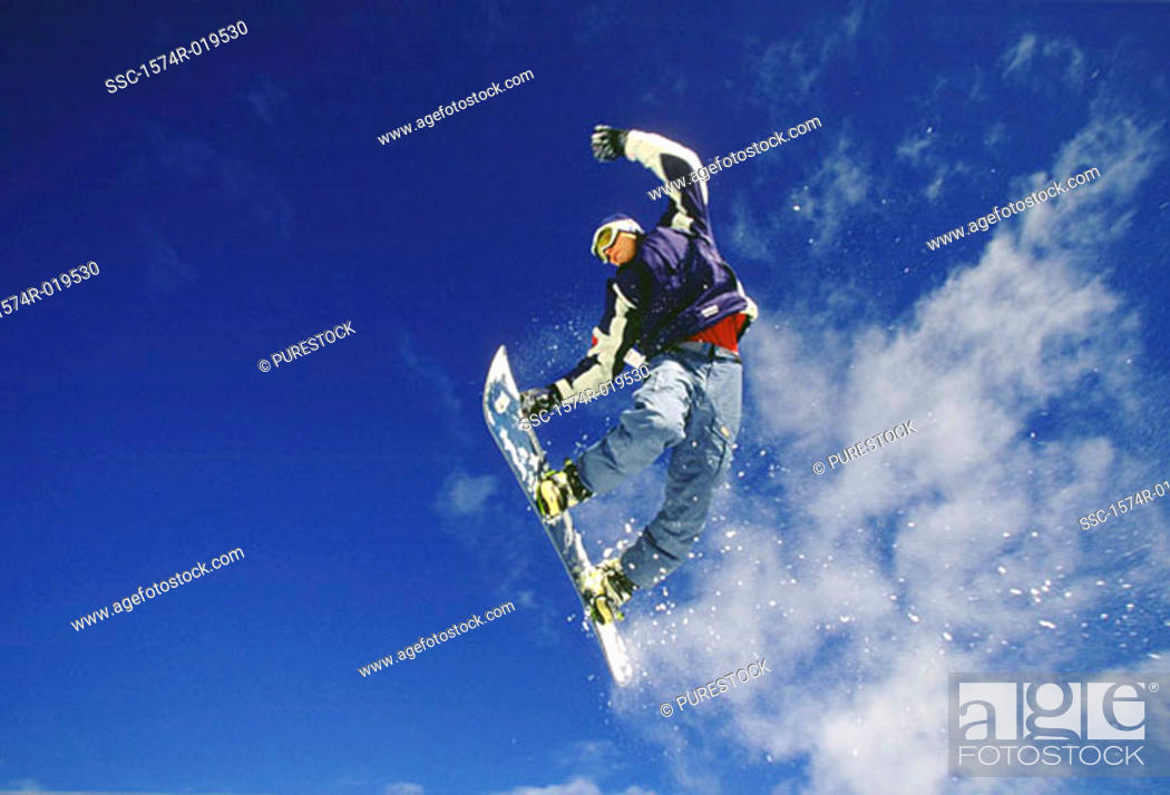 Stock Photo: Teenager performing stunt on snowboard.