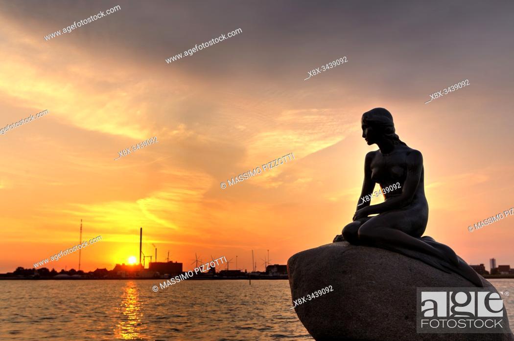 Stock Photo: Statue of the Mermaid in Langelinie at sunrise, Copenhagen, Denmark.