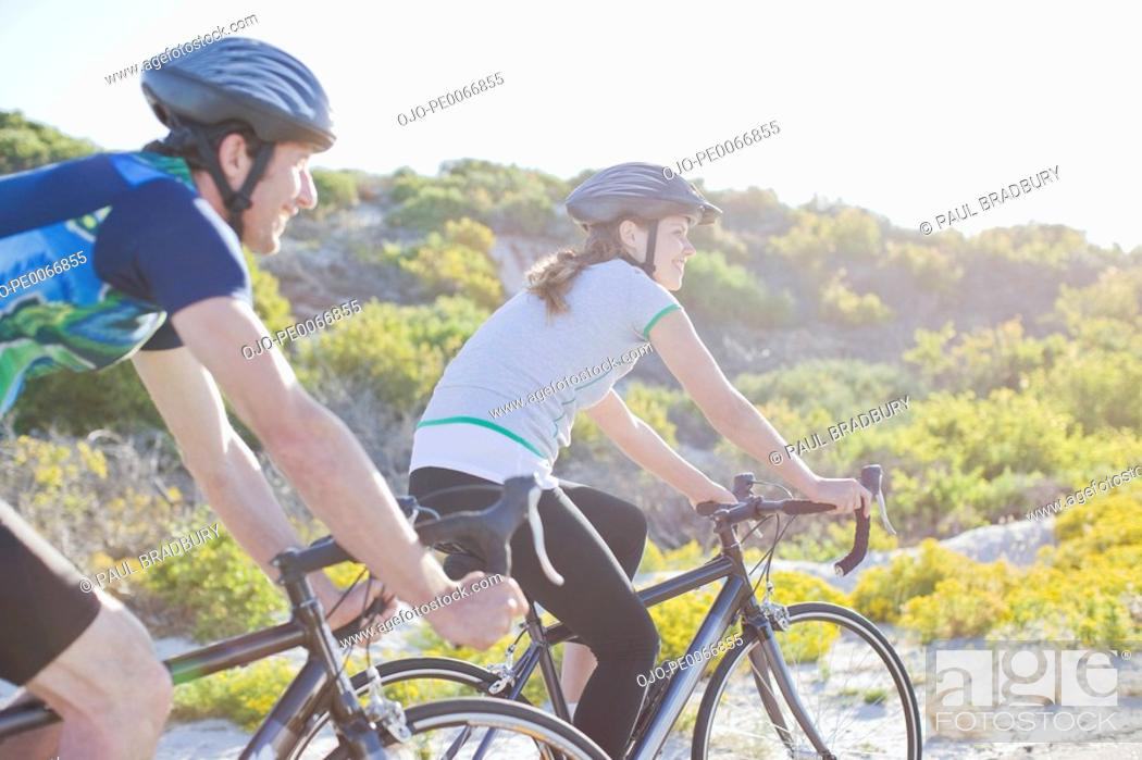 Stock Photo: Couple bike riding in remote area.