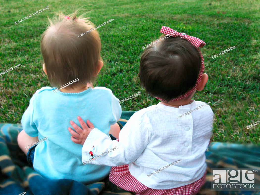 Stock Photo: Two little friends in the back yard.