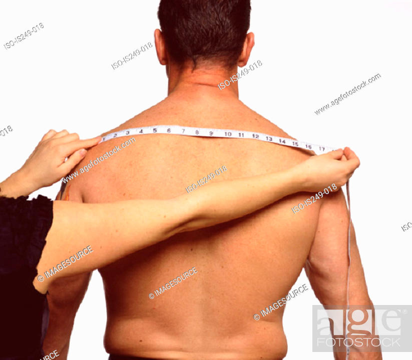 Stock Photo: Measuring across male back.