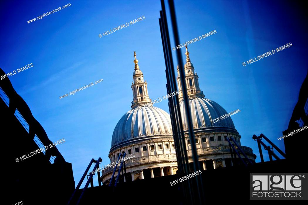 Stock Photo: St Paul's Cathedral dome against deep blue sky reflected in glass of modern building, London, England, Europe.