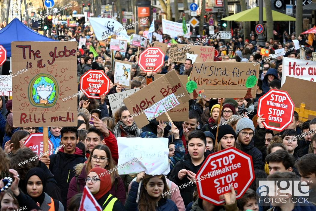 Stock Photo: 29 November 2019, North Rhine-Westphalia, Cologne: Several thousand people are standing in front of a stage in the city centre during a demonstration for.