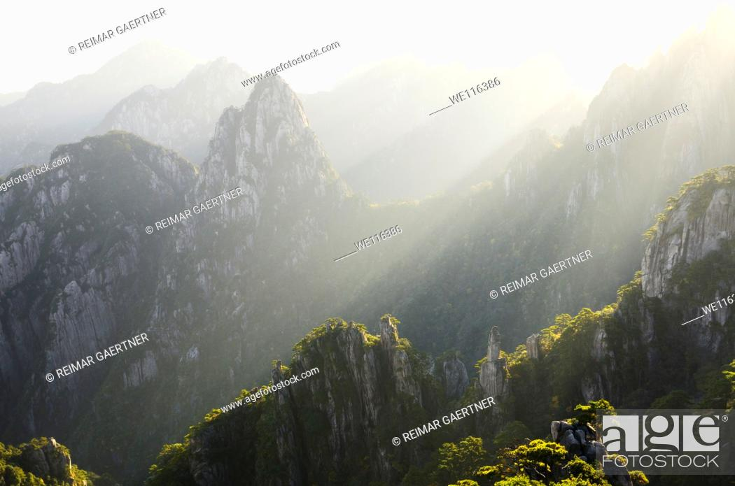 Stock Photo: Streaks of morning light on Camel Back Peaks from Refreshing Terrace North Sea Huangshan Mountain China.