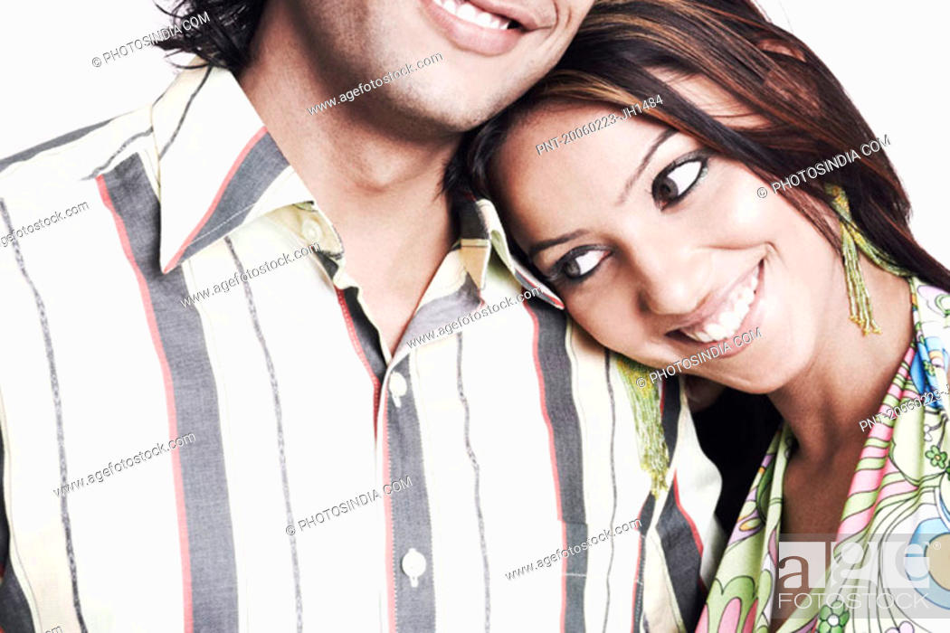 Stock Photo: Close-up of a young woman with her head on a young man''s shoulder.