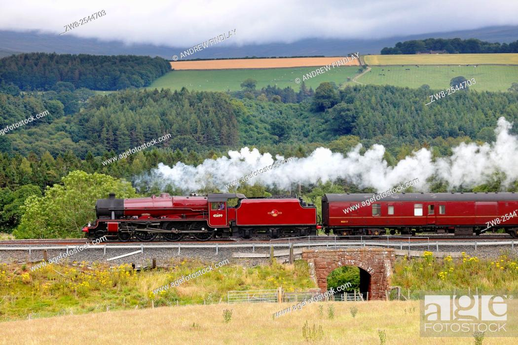 Stock Photo: Steam locomotive LMS Jubilee Class 45699 Galatea on the Settle to Carlisle Railway Line near Lazonby, Eden Valley, Cumbria, England, UK.