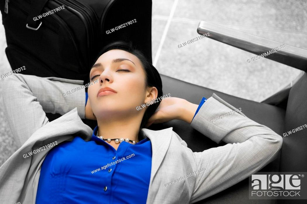 Stock Photo: High angle view of a businesswoman sleeping.