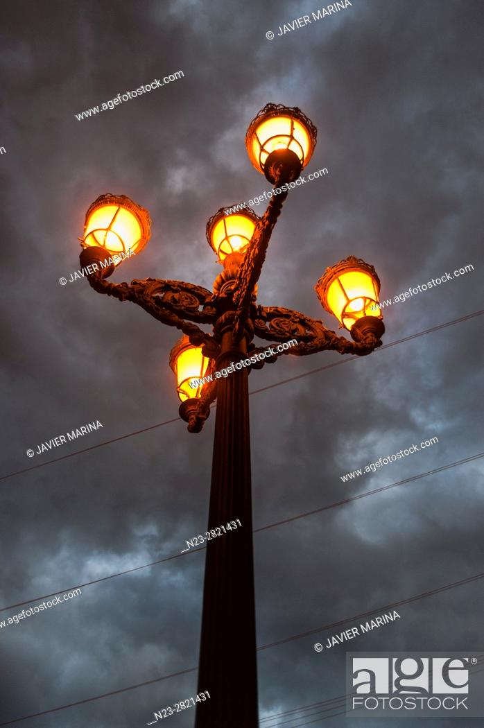 Stock Photo: Lamppost and clouds, Valencia, Spain.