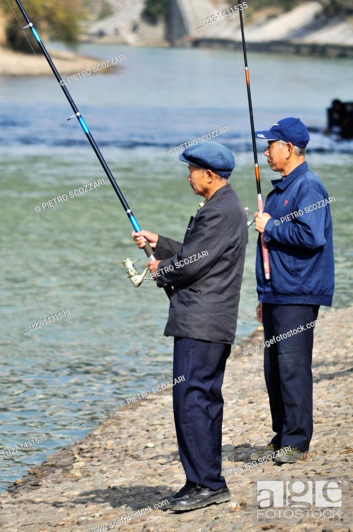 Stock Photo: Guilin (China): two men fishing along the Li River.