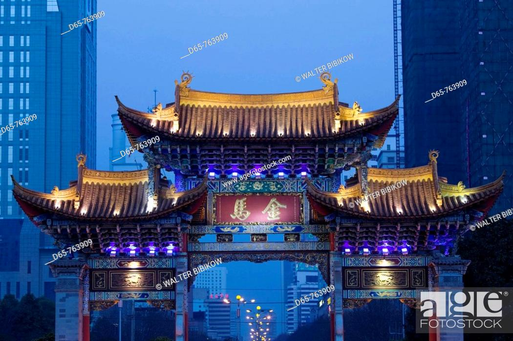 Stock Photo: China. Yunnan Province. Kunming: Memorial Arch of the Golden Horse and Jade Rooster in Jinmabiji Square / Evening.