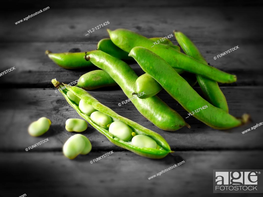 Stock Photo: Fresh green Broad beans in their pods.