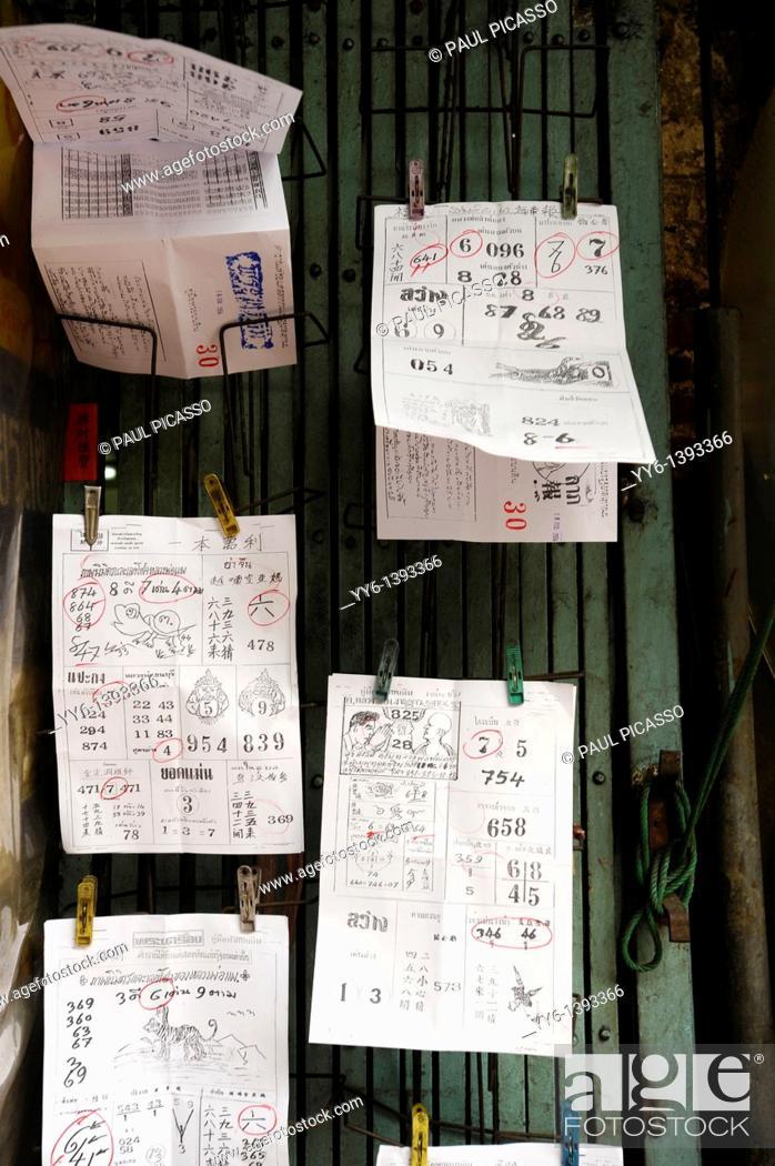 Stock Photo: winning lottery numbers and winning combinations, chinese street lottery, chinatown, bangkok, thailand.