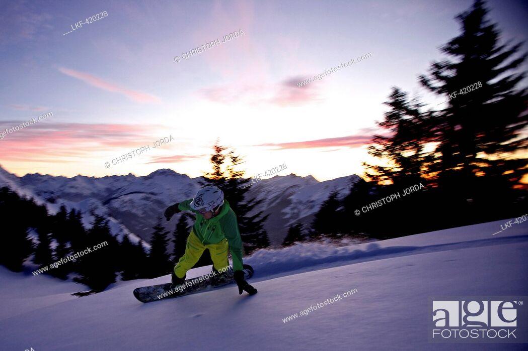 Stock Photo: Snowboarder making a turn in fresh snow, Hahnenkamm, Tyrol, Austria.