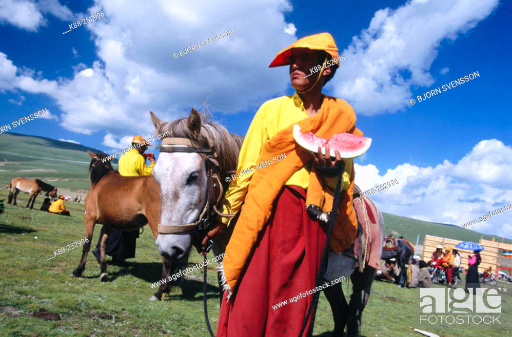 Stock Photo: Monk with water melon. Litang Horse Festival. Sichuan. West China.