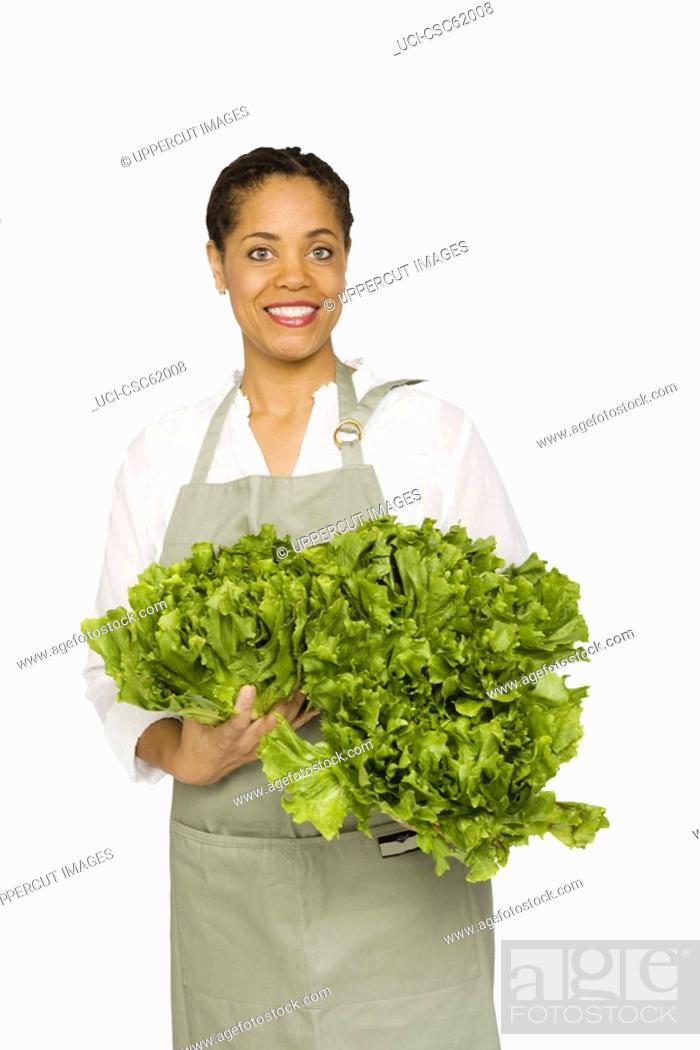 Stock Photo: Woman holding fresh produce.