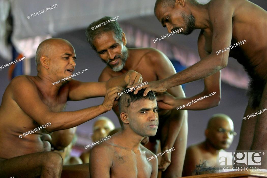 Stock Photo - Naked sadhu shaving-off hairs of person who is taking Deeksha  ; initiation ceremony to become monk at Mahamasthakabhisheka Jain festival  ...