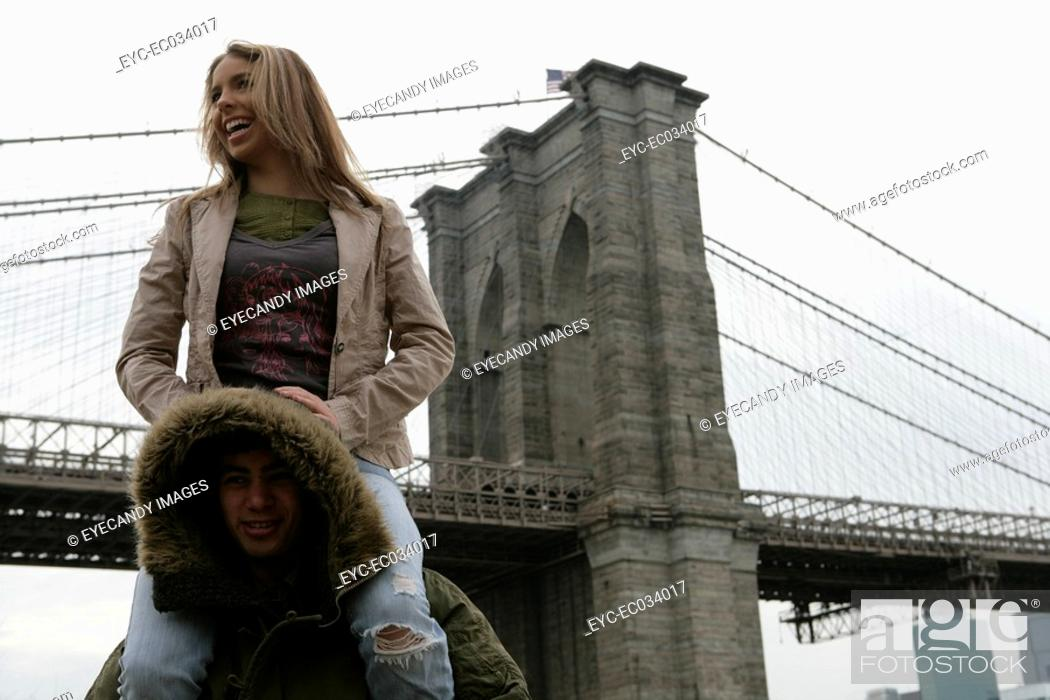 Stock Photo: View of a man carrying a woman.