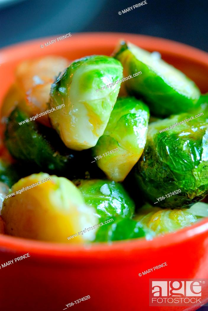 Stock Photo: Brussel sprouts in an orange bowl.