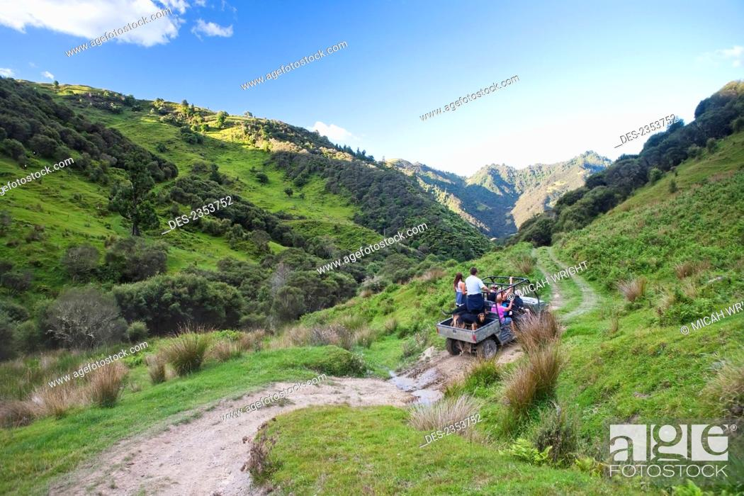 Stock Photo: Travelers Explore The Grounds Of The Blue Duck Lodge On A Buggy Tour, Whanganui National Park; Whakahoro, New Zealand.