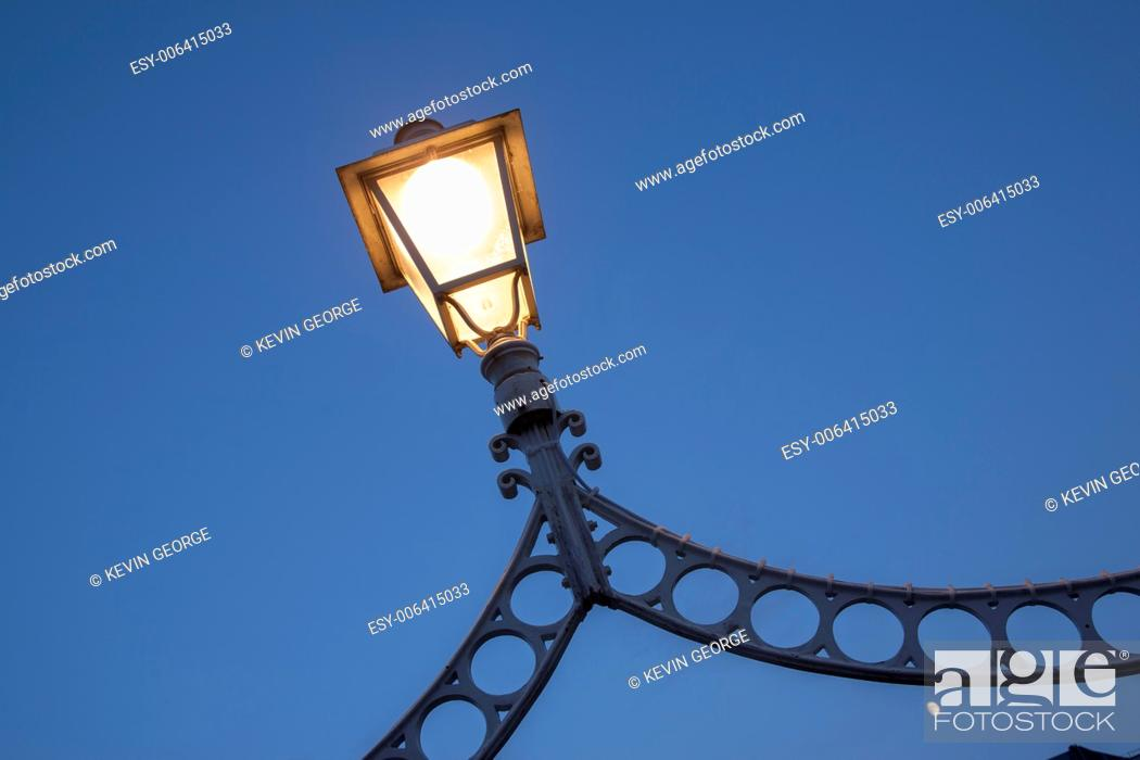 Stock Photo: Illuminated Lamp on Ha'Penny Bridge, Dublin, Ireland.