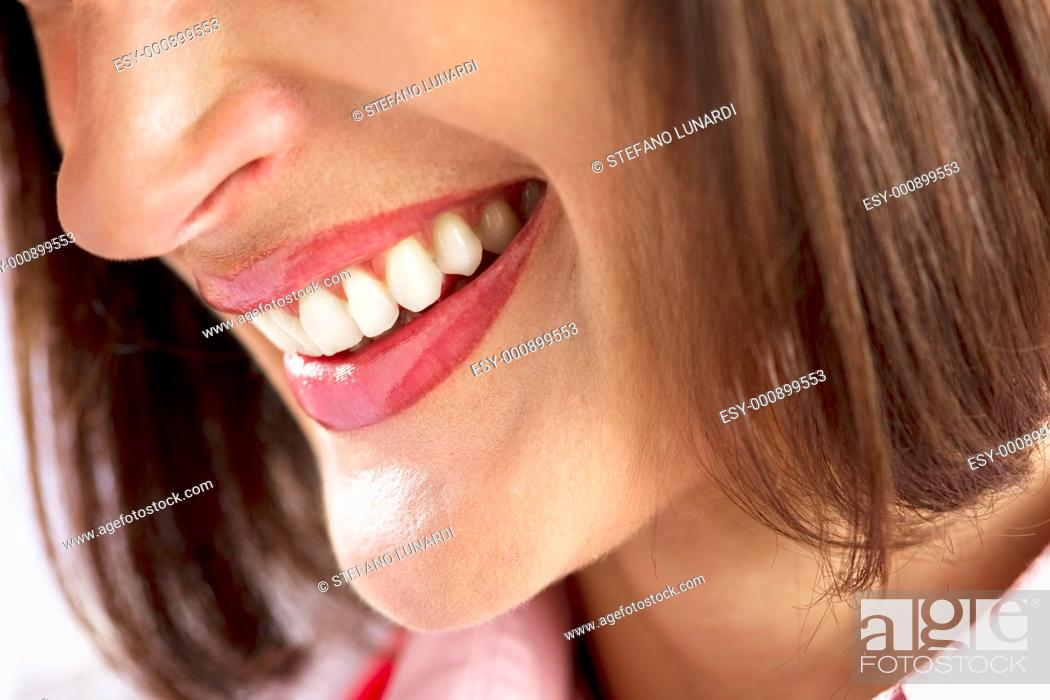 Stock Photo: Close-up of a beautiful woman smile.
