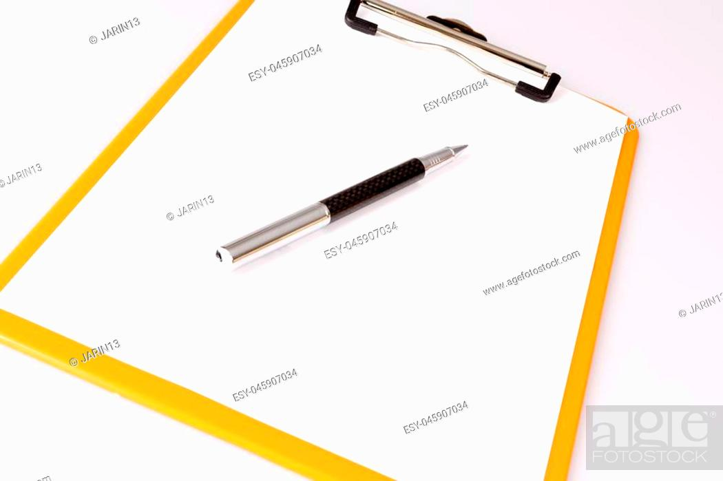 Stock Photo: pen or pencil on empty paper in brown clipboard on white - business concept.