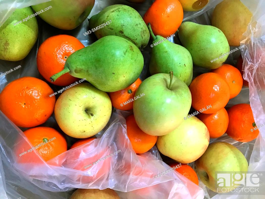 Stock Photo: Fruits in plastic bag.