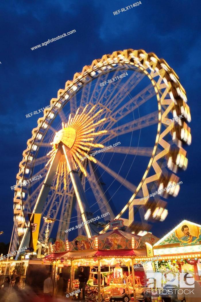 Stock Photo: Illuminated Ferris wheel at night, Oktoberfest beer festival, Munich, Germany.