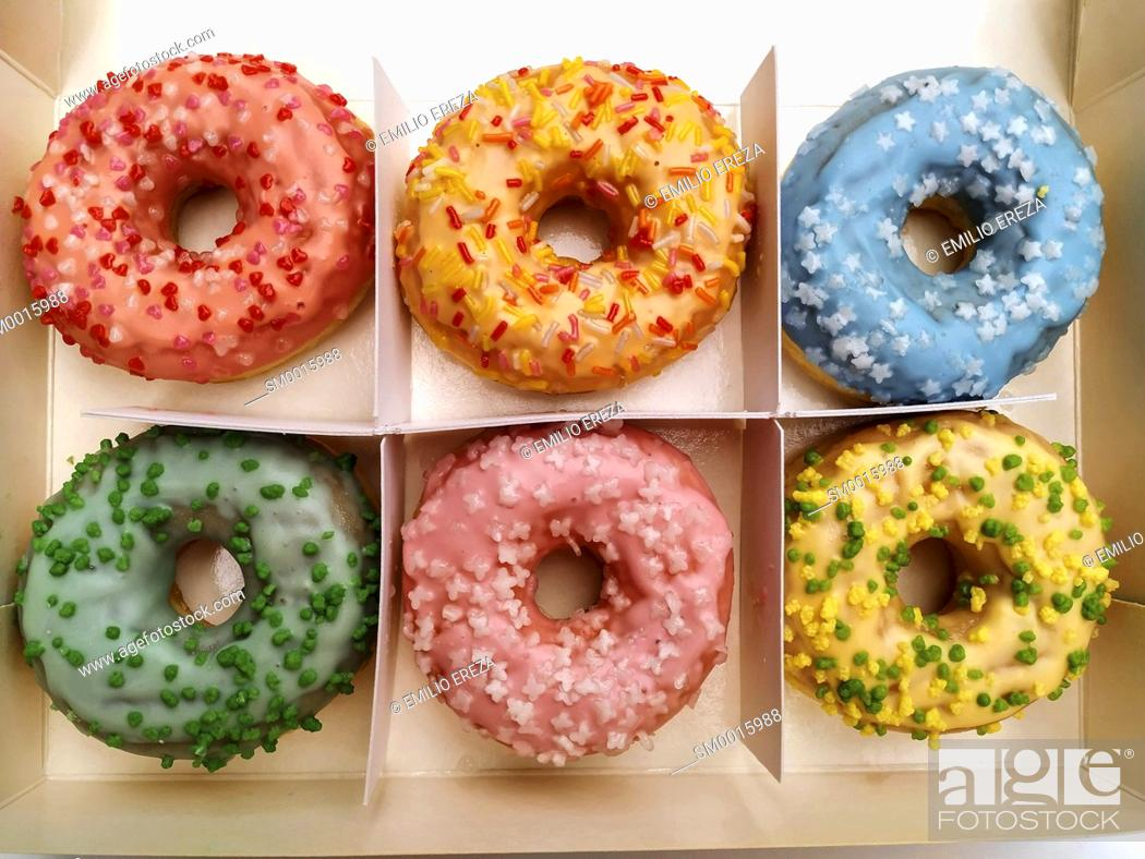 Stock Photo: Varied donuts for sale.