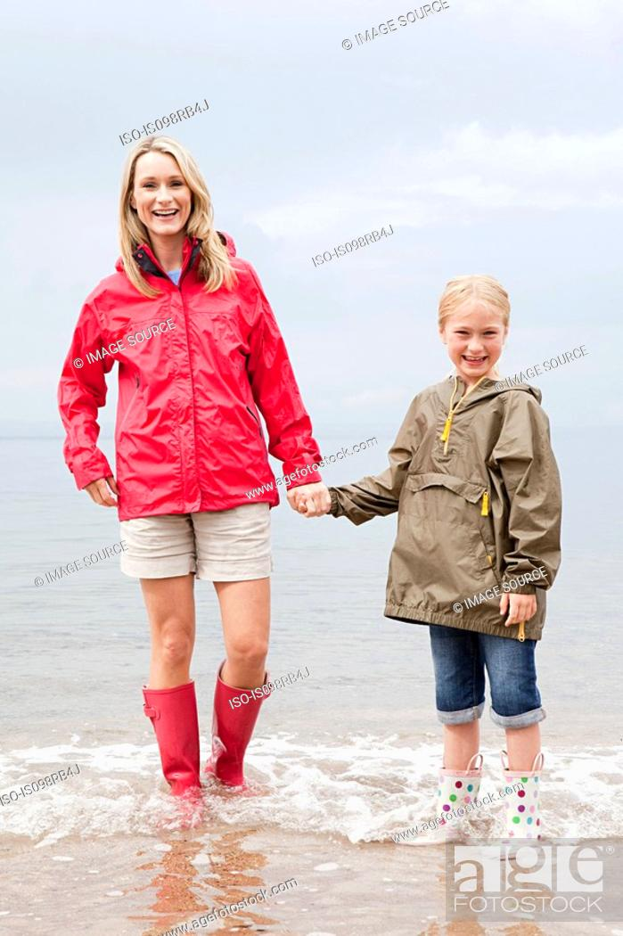 Stock Photo: Mother and daughter standing in the sea.