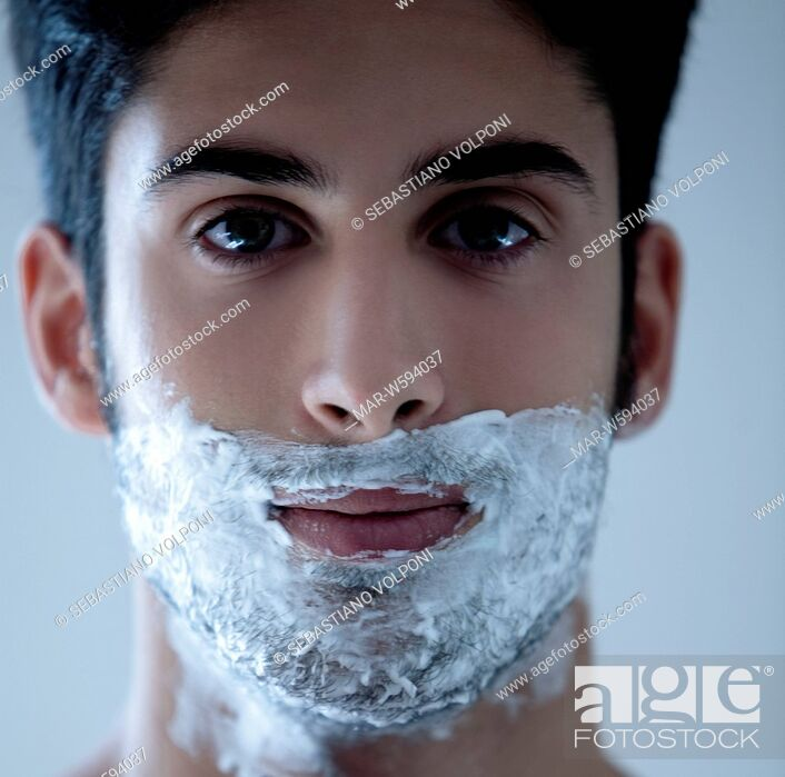 Stock Photo: man with shaving foam on his face.