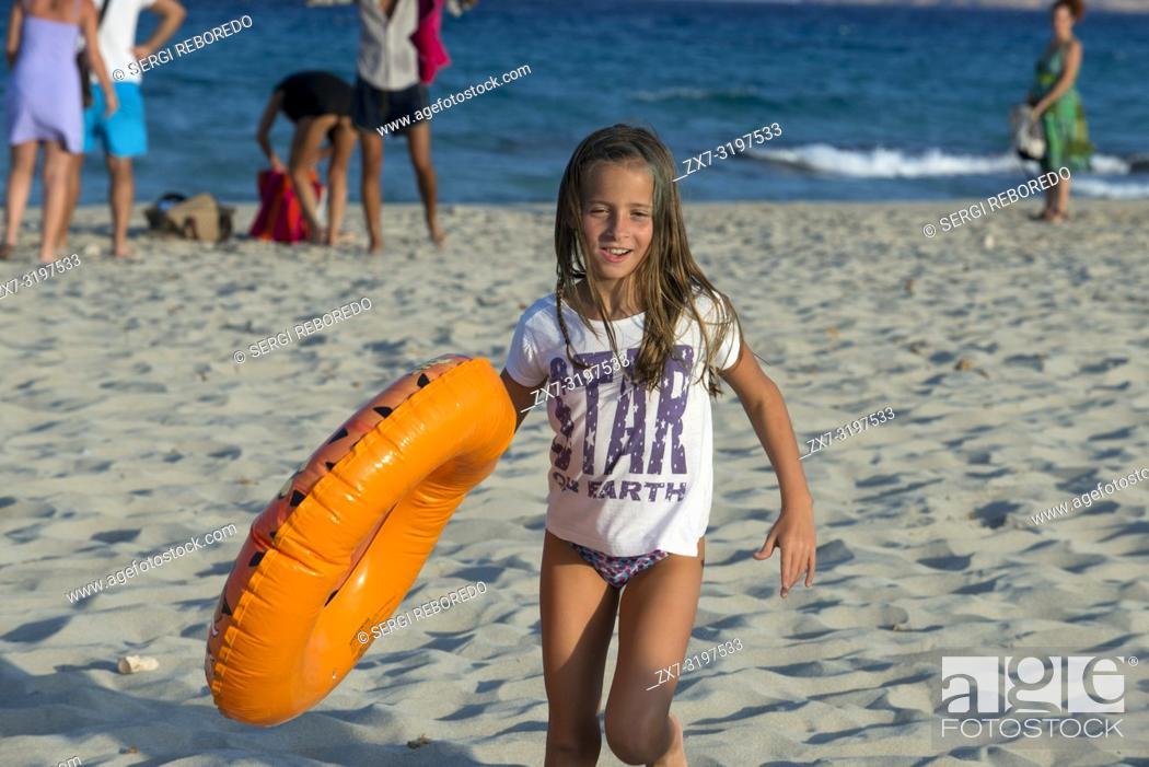 Stock Photo: Sa Roqueta Beach and Ses Illetes Beach, Balearic Islands, Formentera, Spain. Funy girl with floats.