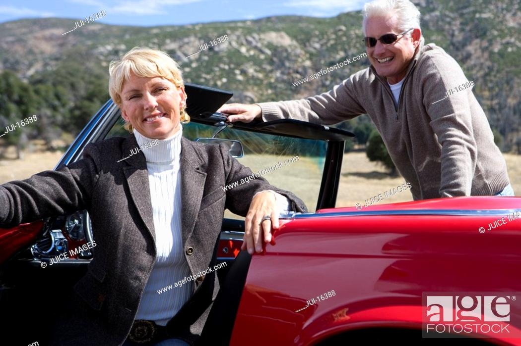 Stock Photo: Couple posing in red convertible.