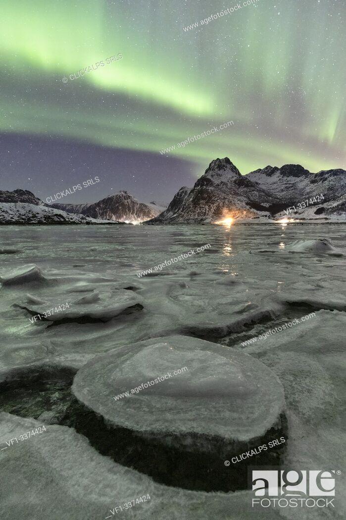 Stock Photo: A magical night whit Aurora borealis around Flakstad beach, Lofoten Islands, Northern Norway, Europe.