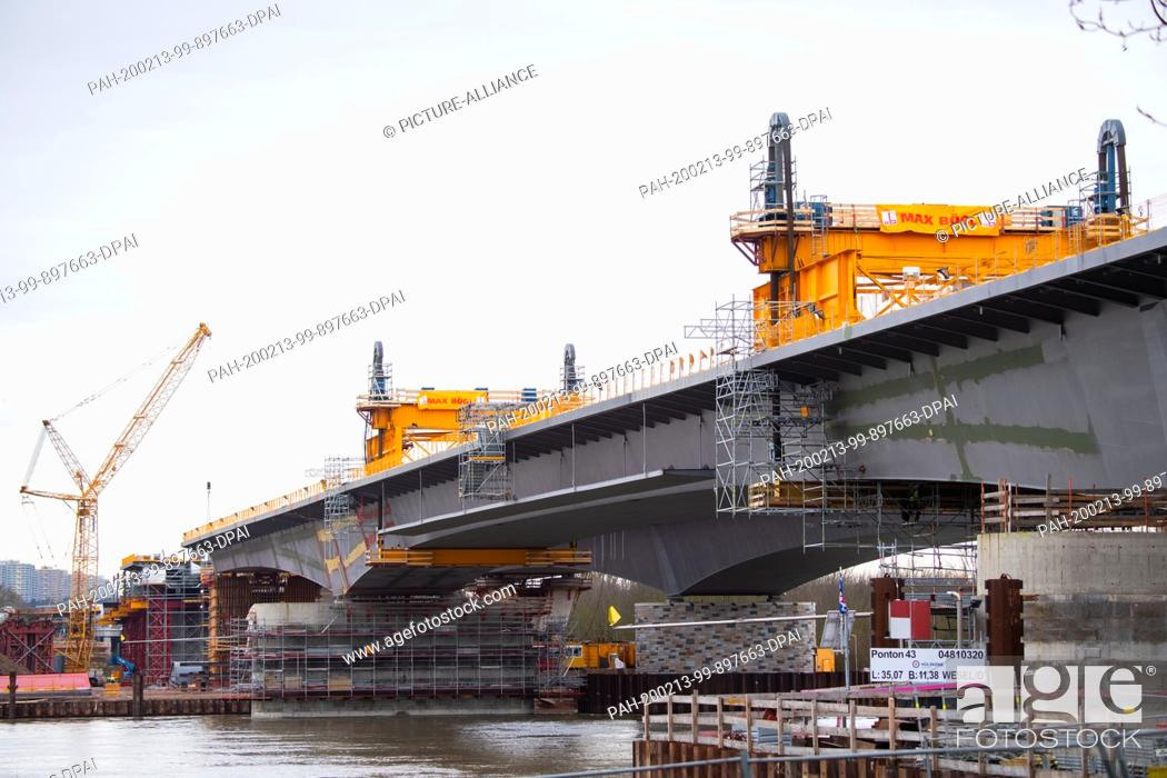Stock Photo: 13 February 2020, Hessen, Wiesbaden: The new bridge element has reached its final position. To complete the Schiersteiner Bridge (A 643), a 120-metre long and 2.