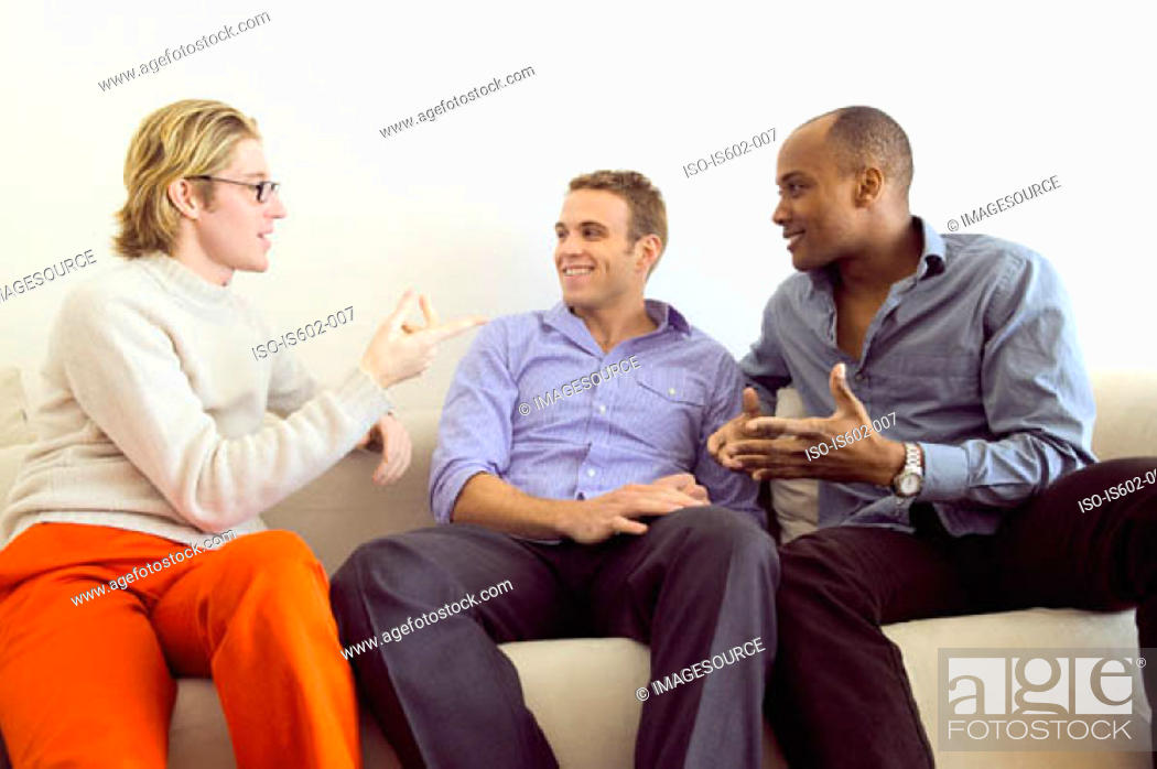 Stock Photo: Men talking on sofa.
