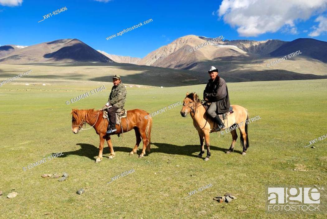 Stock Photo: Nomad horsemen. Altai Republic, Siberia, Russia, Asia.