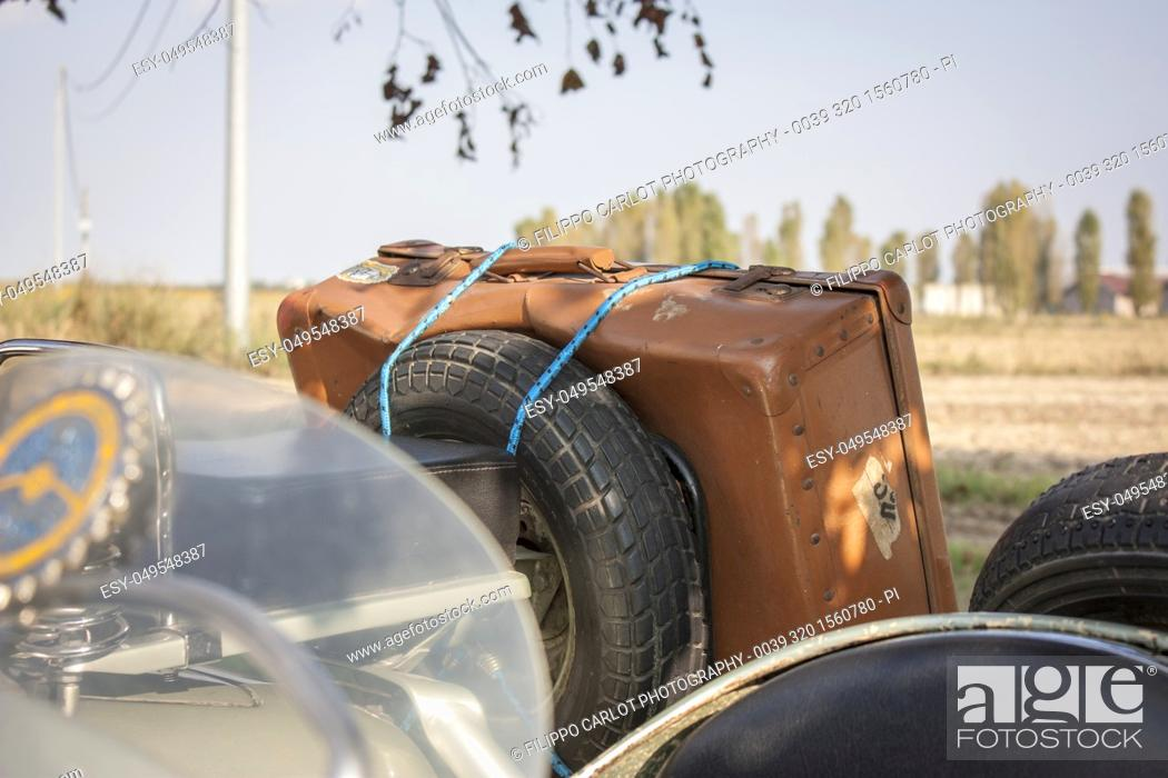 Stock Photo: Old vintage leather suitcase, attached to an old vintage vehicle Italian ready to go and venture into a new journey. Abientazione: Italian countryside.