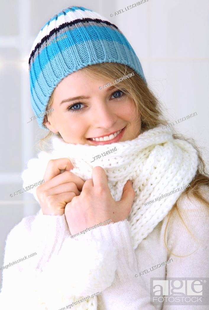 Stock Photo: portrait of young woman wearing scarf.