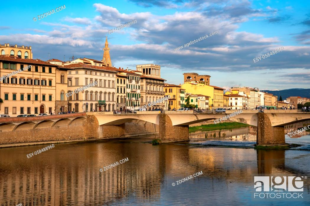 Stock Photo: FLORENCE, TUSCANY/ITALY - OCTOBER 18 : View of buildings along and across the River Arno in Florence on October 18, 2019. Unidentified people.