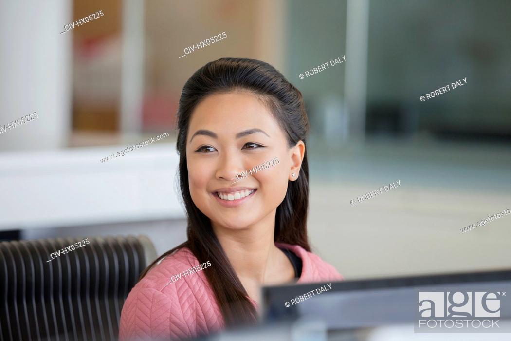 Stock Photo: Portrait smiling, confident businesswoman in office.