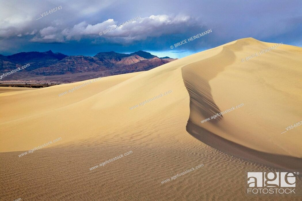 Stock Photo: Breaking thunderstorm over Mesquite Dunes, Death Valley National Park, California.