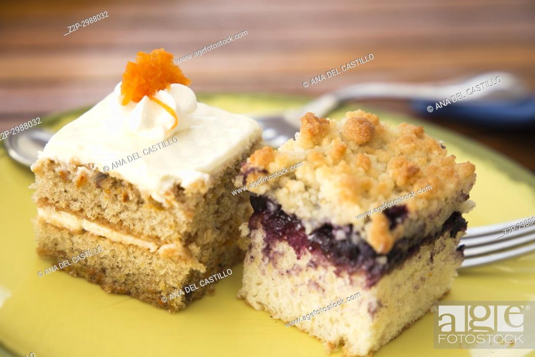 Photo de stock: Two pastries on yellow plate.