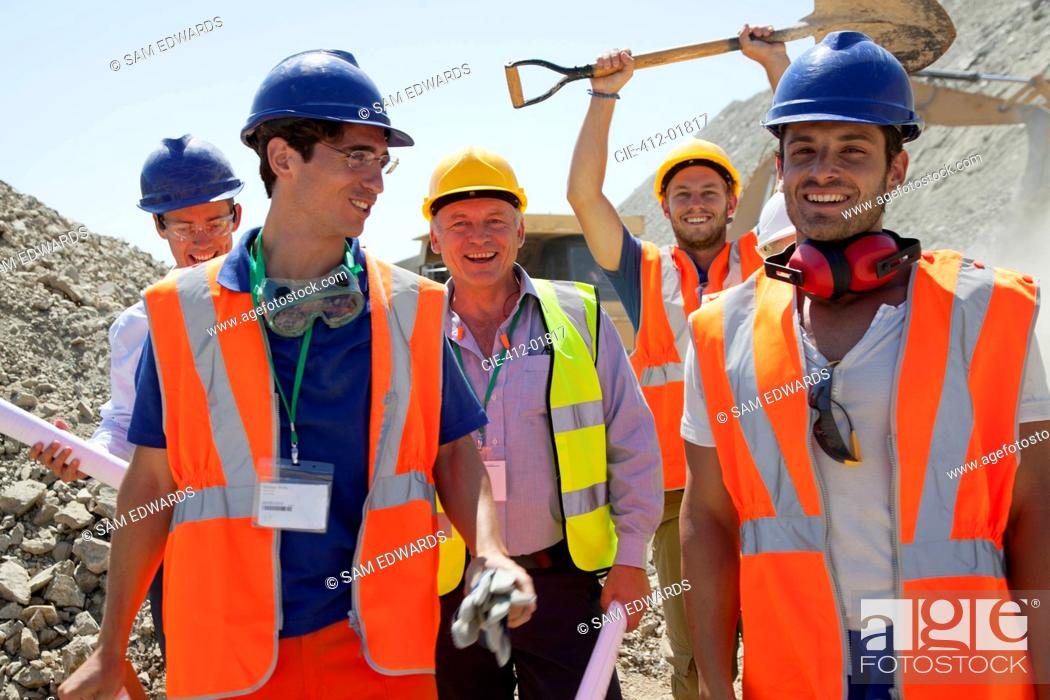 Stock Photo: Workers smiling together in quarry.