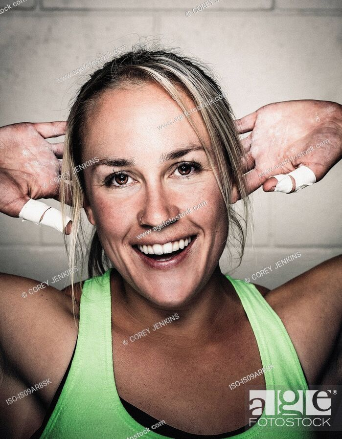 Stock Photo: Portrait of smiling mid adult woman before workout.