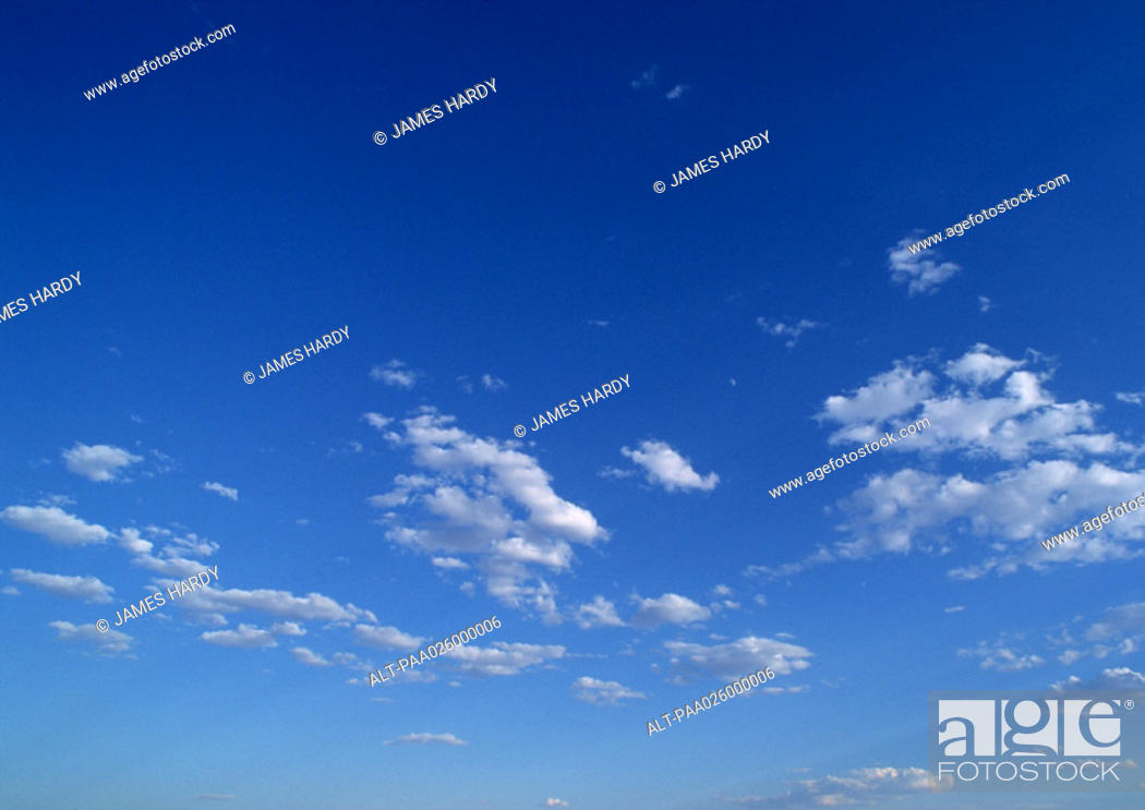 Stock Photo: Sparse clouds in blue sky.