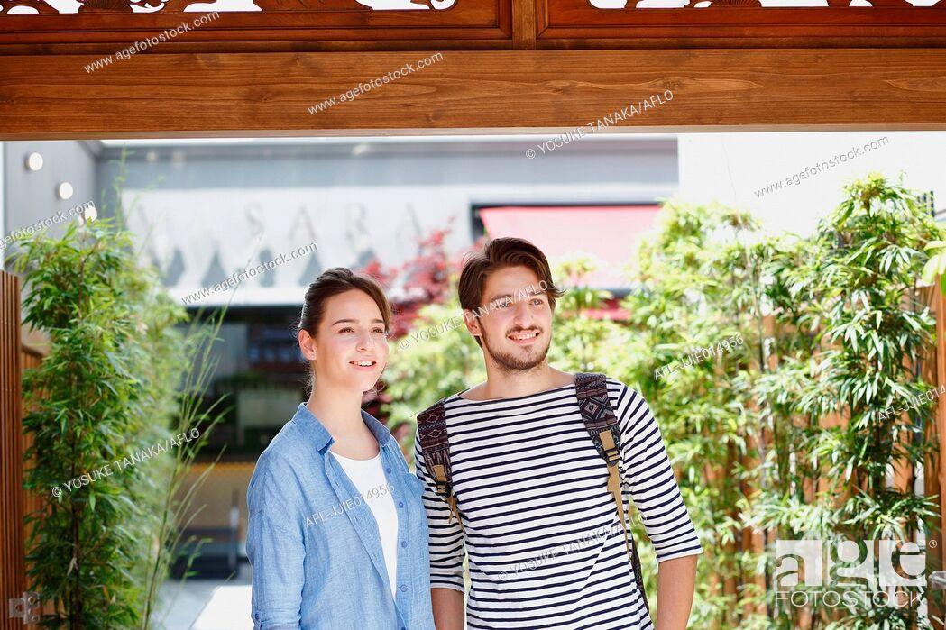 Stock Photo: Caucasian couple enjoying sightseeing in Tokyo, Japan.