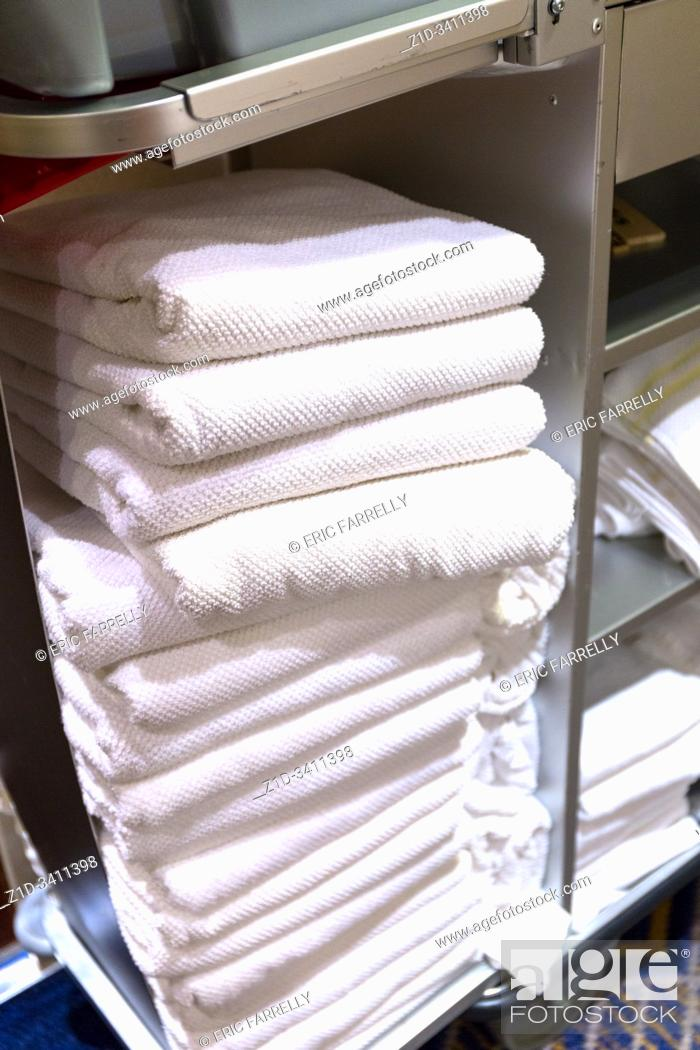 Stock Photo: Clean towels for Passenger cabins. Cunard ship. Queen Mary 2. QM2.