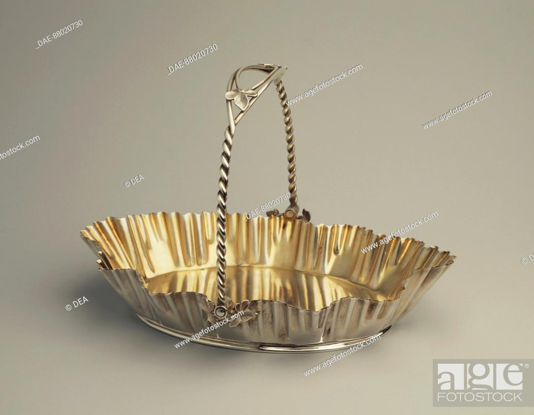 Stock Photo: Silversmith's Art, England beginning of 20th century. Sheffield plate, smooth basket with handle.  Private Collection.